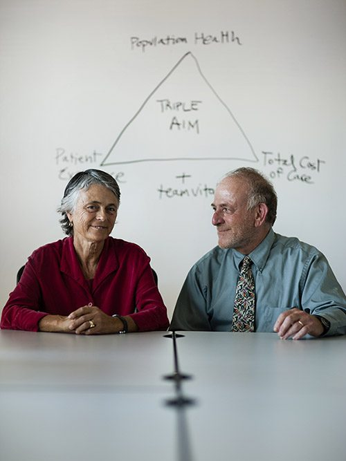 Ann and Alan Glaseroff sitting next to each other, smiling.