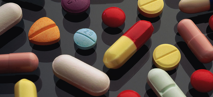 pills arranged on dark surface