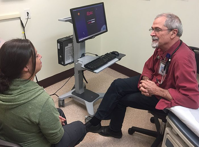 Bill Hunter speaking to a medical assistant at Open Door Community Clinic at Willow Creek in Humboldt County