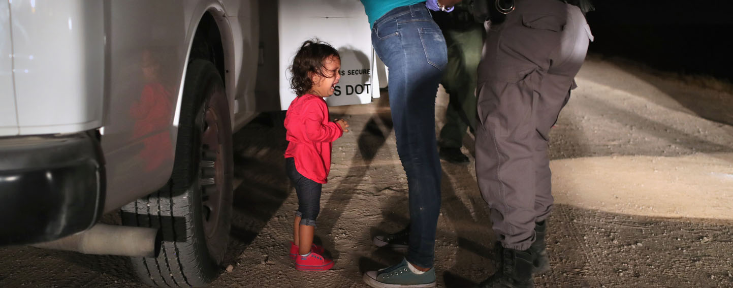 MCALLEN, TX - JUNE 12: A two-year-old Honduran asylum seeker cries as her mother is searched and detained near the U.S.-Mexico border