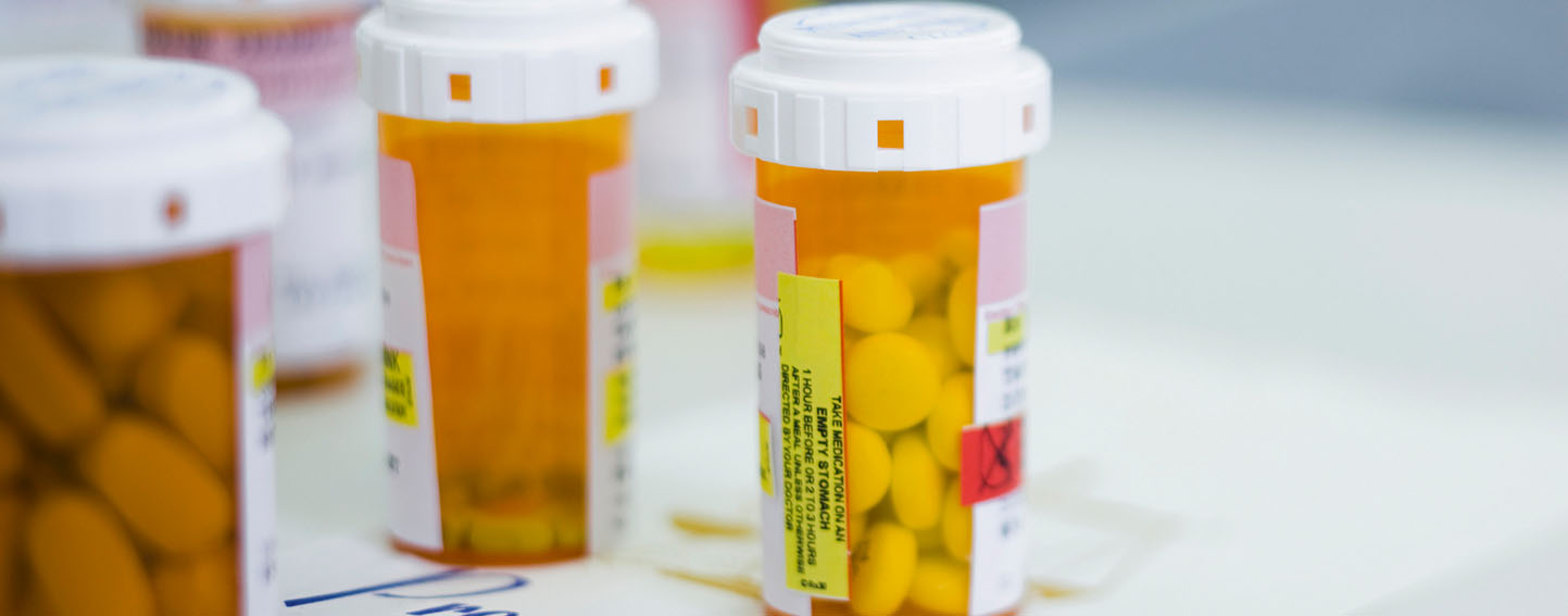 close up of three perscription pill bottles