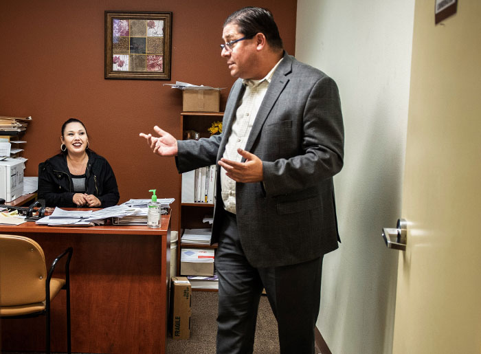 Bill Tarkanian, director of program development for the Los Angeles Centers for Alcohol and Drug Abuse, right, talks Community Service manager Rachel Carrillo, at their treatment center in Santa Fe Springs, California.