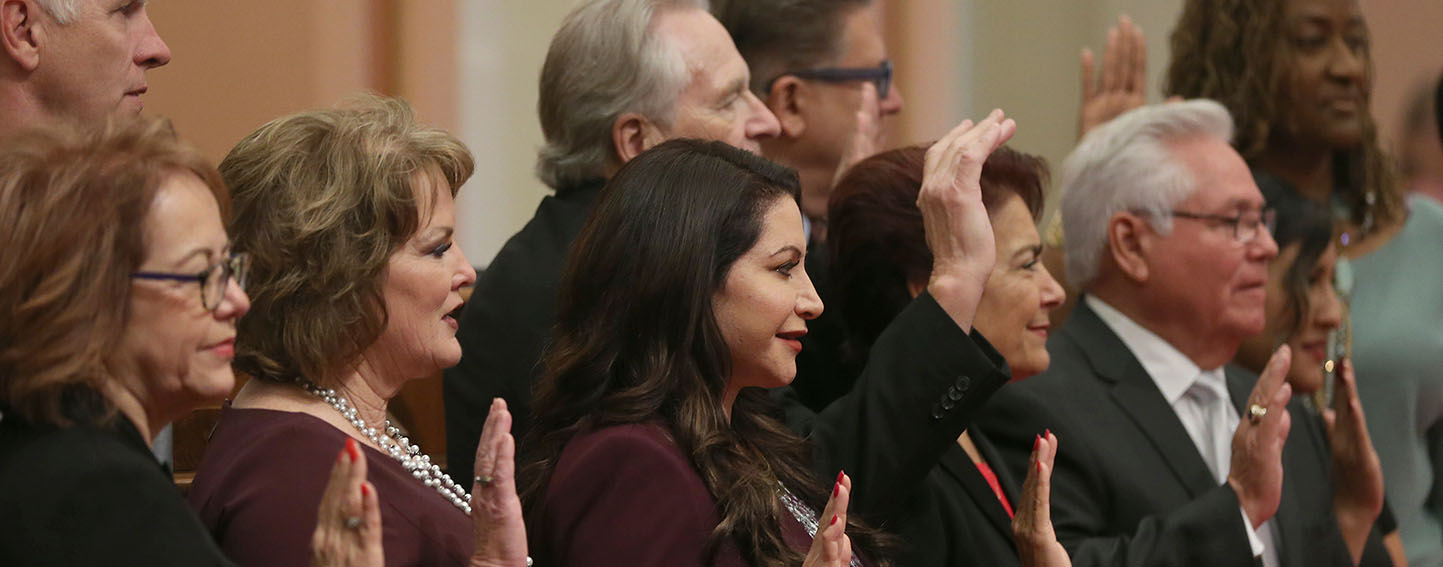 Members of the state Senate take the oath of office, Monday, Dec. 3, 2018, in Sacramento, Calif.