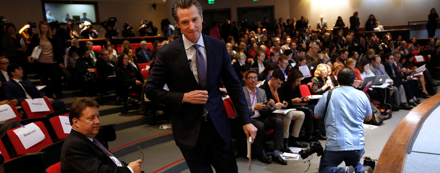 California Gov. Gavin Newsom walks to the auditorium stage to present his first state budget during a news conference Thursday, Jan. 10, 2019,