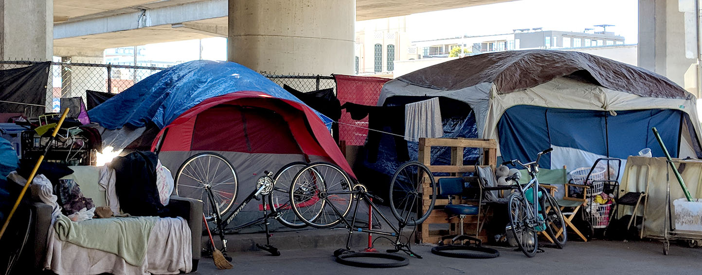 Tents pitched under freeway in Oakland, CA