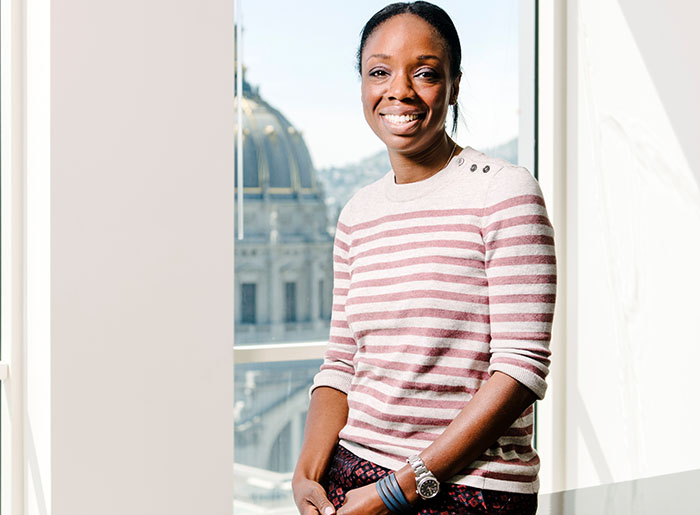 Portrait of Dr. Nadine Burke Harris, California's first Surgeon General, in her office overlooking San Francisco City Hall