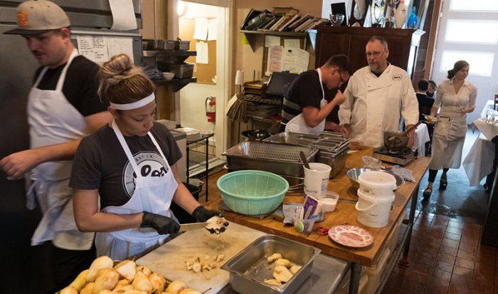 Chef Patrick Mulvaney talks with his kitchen staff