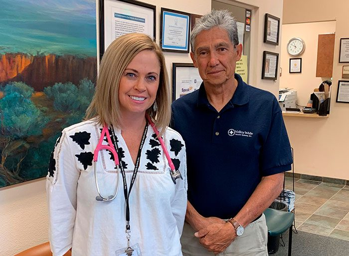 Christy Smith, NP, and Joseph Quintana, MD stand in the reception area of Valley-Wide Health System's clinic in San Luis Colorado