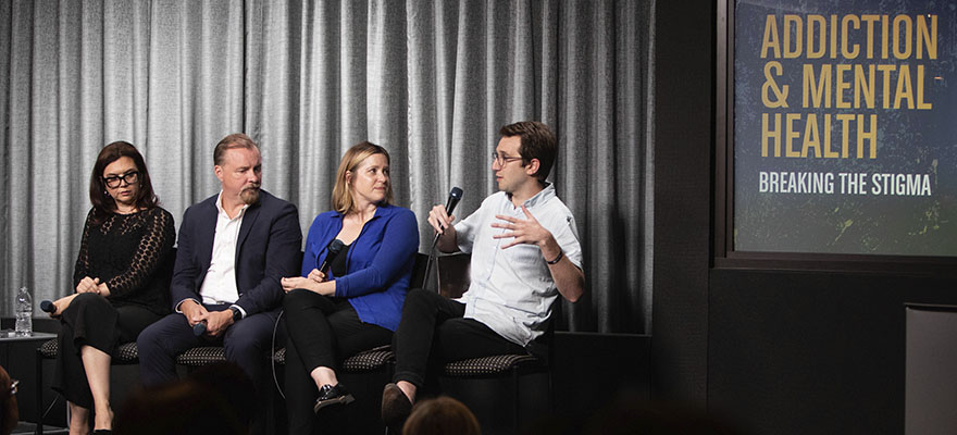 "Journalist Zachary Siegel, right, at the Hollywood, Health, and Society event ""Addiction & Mental Health: Breaking the Stigma."" Other panelists included, from left, Gemma Baker, co-creator of Mom; Corey Waller, MD, addiction expert; and Holly Daniels, PhD, California Association of Marriage and Family Therapists."