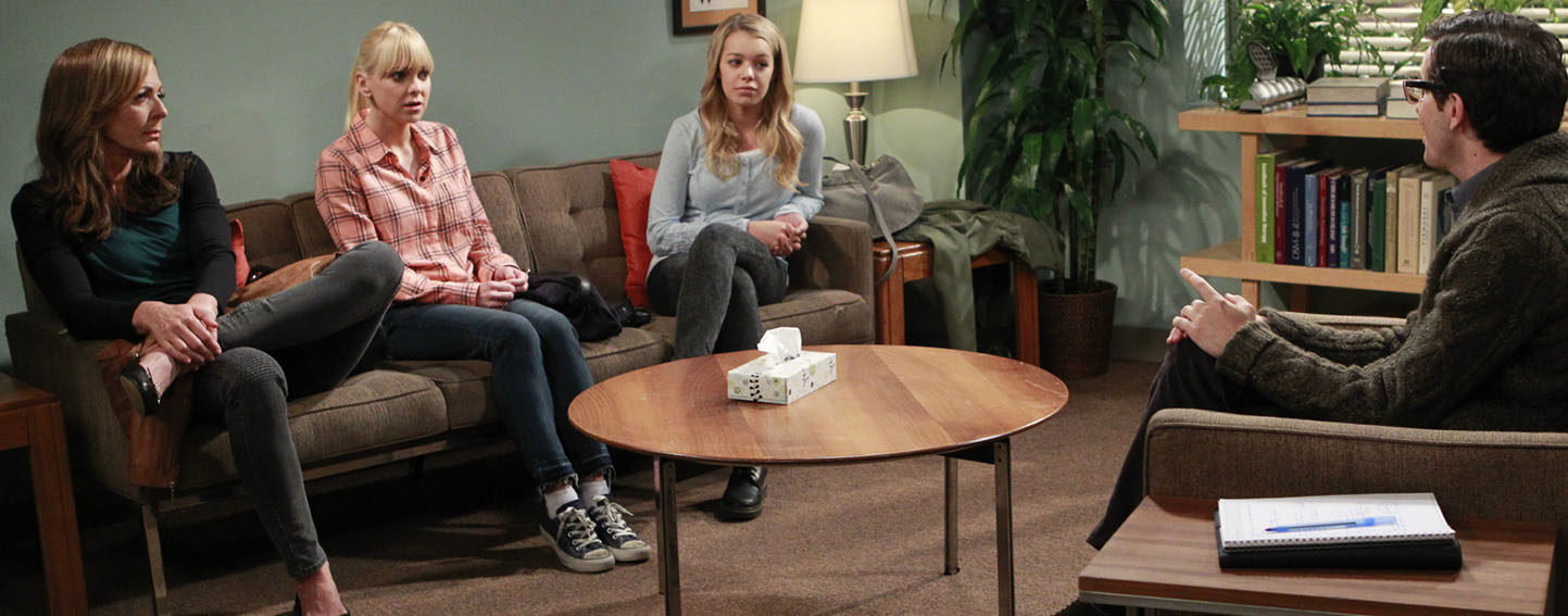 Characters from the Mom television series participate in a group therapy session.