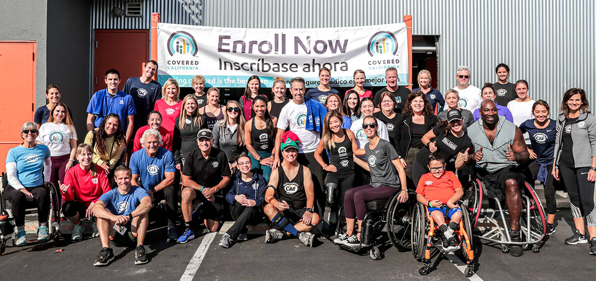 Group photo of Covered Califiornia staff with the atheletes of the Challenged Atheletes Foundation