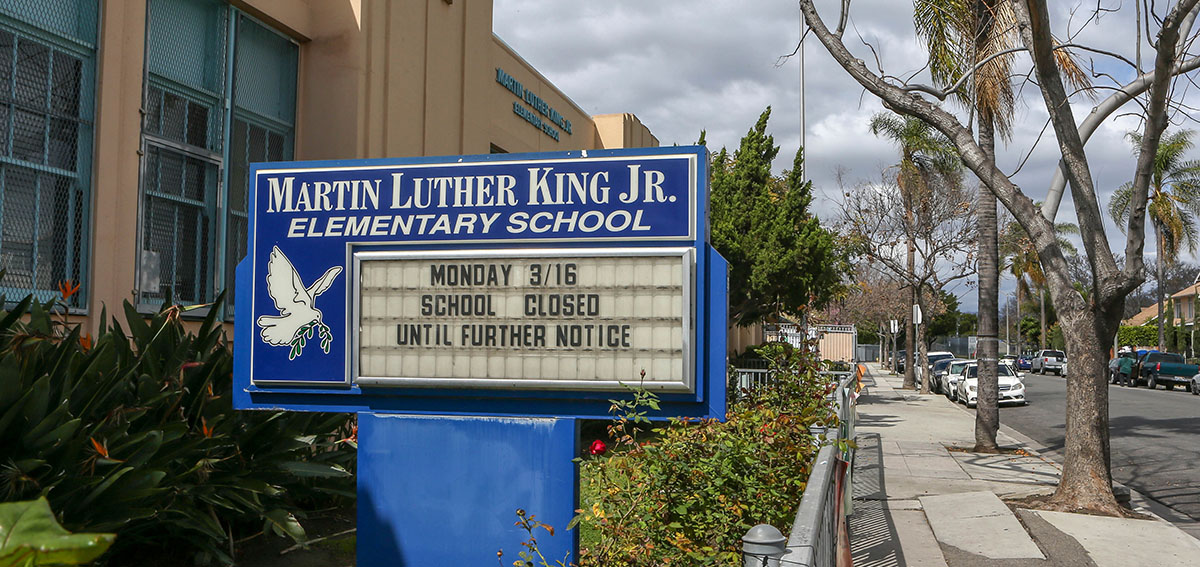"""Martin Luther King Jr. Elementary School sign reads """"Monday 3/16 School Closed Until Further Notice"""""""