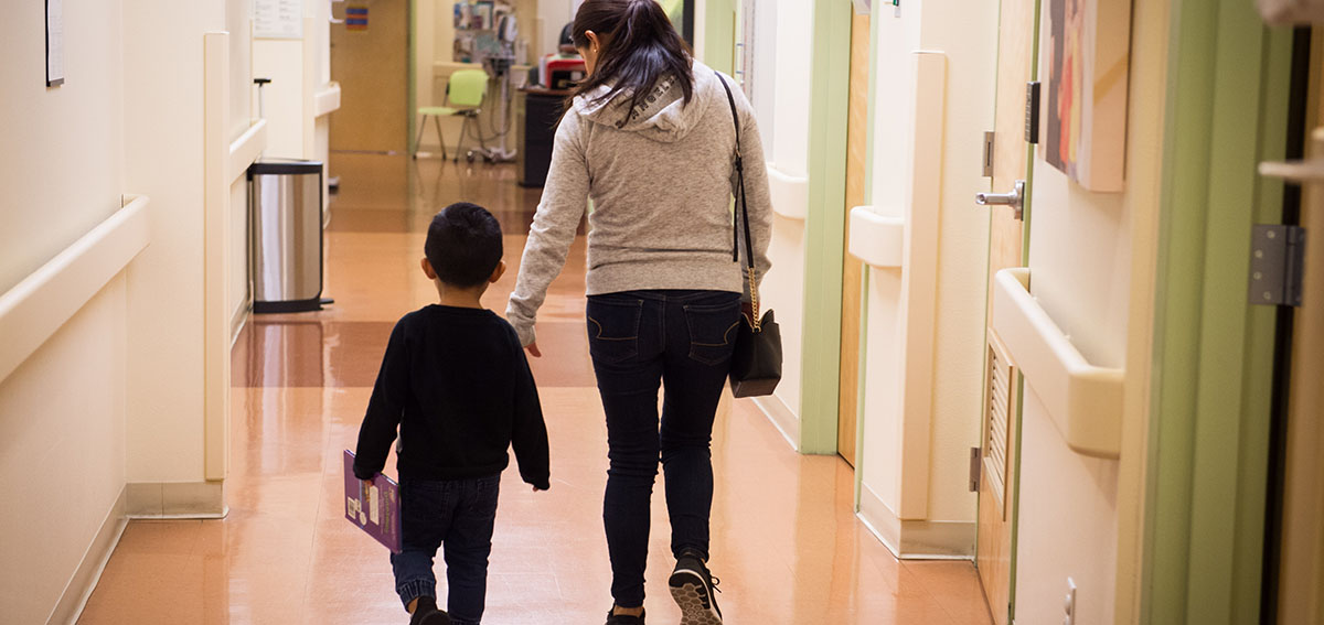 Mother and child walking away from doctor's office