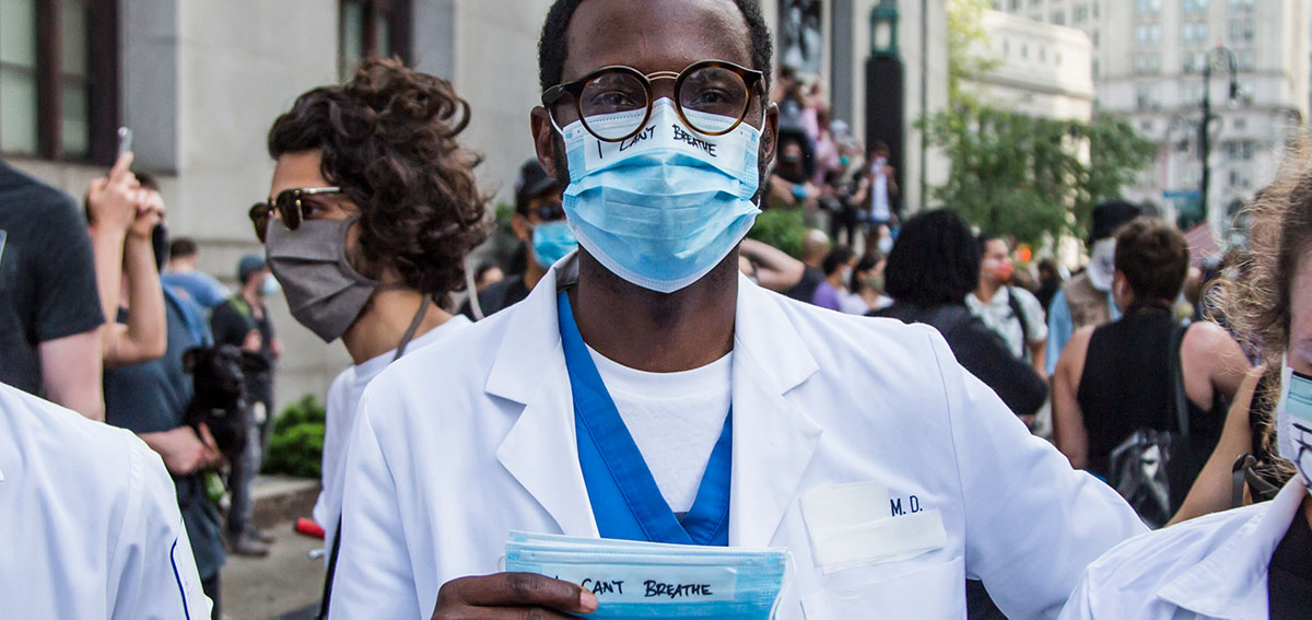A Black physician protests in Brooklyn, New York.