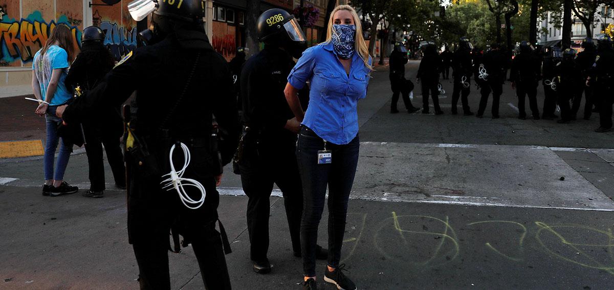 Oakland police arrest a KPIX-5 reporter at police brutality protest