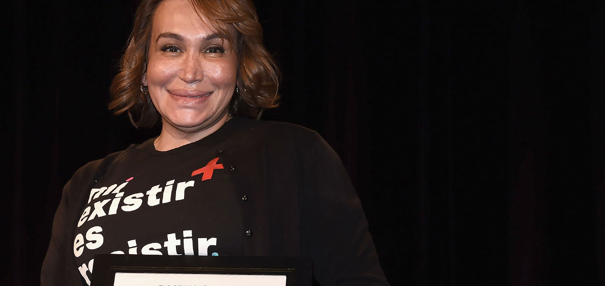 """Cecilia Gentili seen on stage during World AIDS Day at Baruch College on November 30, 2018 in New York City. T-shirt reads """"My existance is resistance."""" (Photo by Gary Gershoff/Getty Images for Housing Works)"""