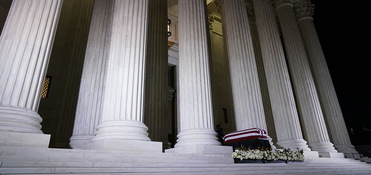 The casket of Justice Ruth Bader Ginsburg lies in repose on the steps of the Supreme Court