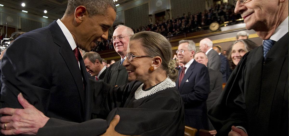 U.S. President Barack Obama greets Supreme Court Justice Ruth Bader Ginsburg