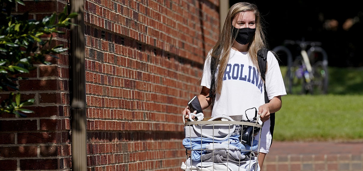 Student leaves campus following a cluster of COVID-19 cases at the University of North Carolina in Chapel Hill