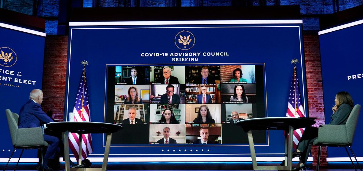 President-elect Joe Biden and Vice President-elect Kamala Harris listen during a meeting with Biden's COVID-19 advisory council