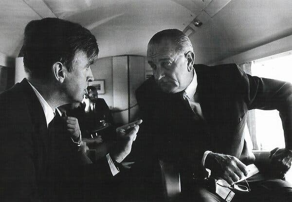 Phil Lee speaks with President Lyndon B. Johnson aboard Airforce One