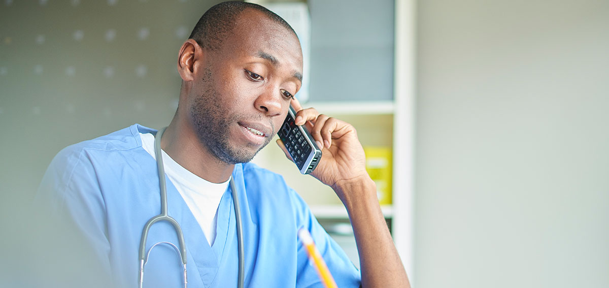 Doctor conducting a telehealth visit by phone