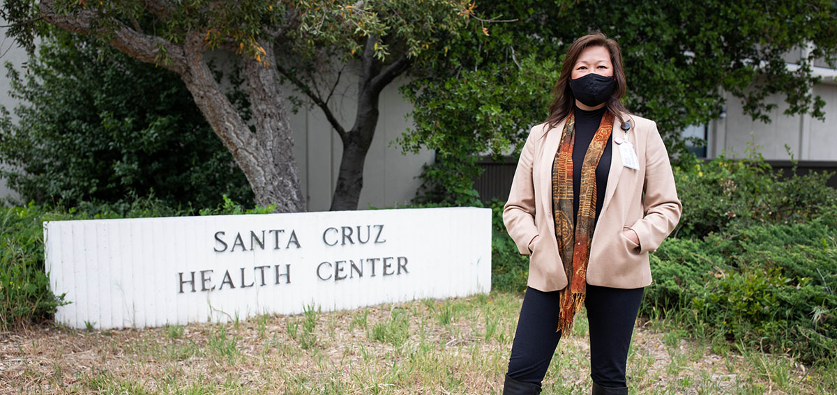 Santa Cruz County health services director Mimi Hall stands in front of the sign for the Santa Cruz County Health Center