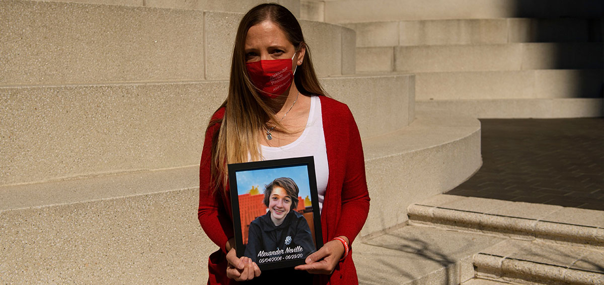 Amy Neville stands for a portrait with a picture of her son Alexander Neville, who died in June 2020 at the age of 14 of fentanyl poisoning.