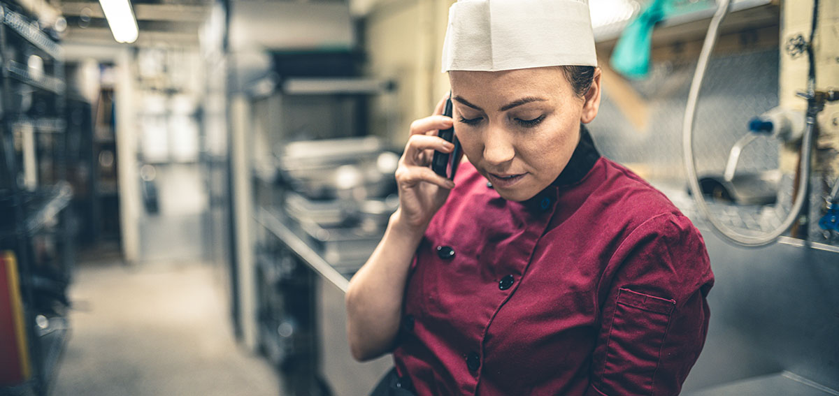 Chef taking a call on cellphone