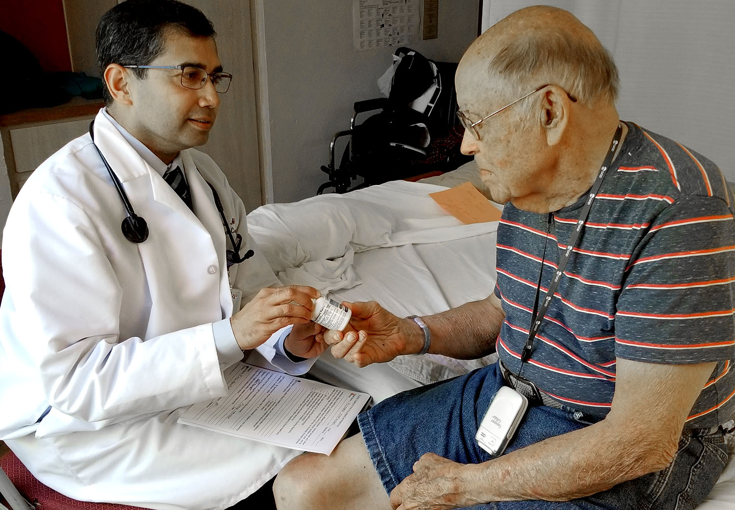 Dr. Parag Agnihotri with patient is Richard Maringer at Sharp Rees-Stealy Medical Group in San Diego.