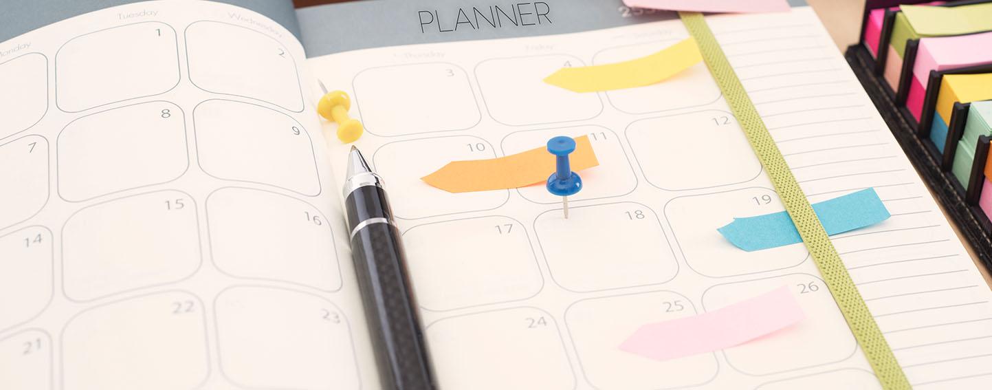 closeup of calendar-style planner notebook