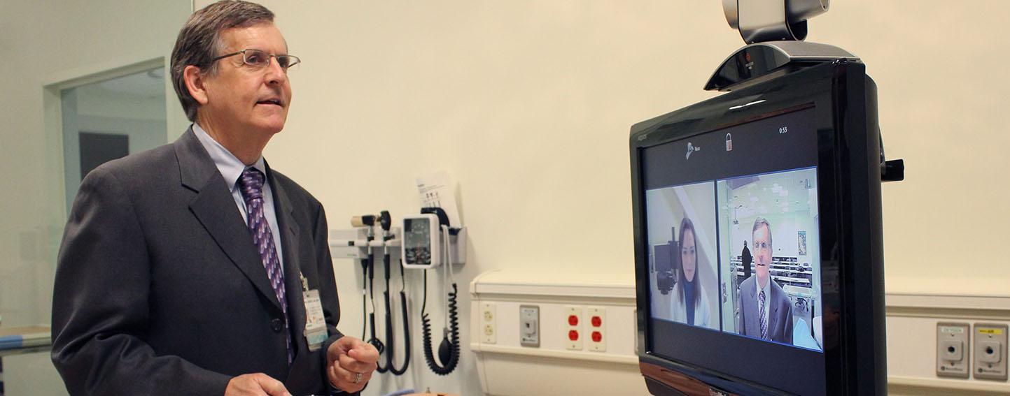 Dr Nesbit on telehealth video conference